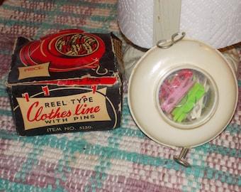 cc-vintage portable clothesline with clothespins