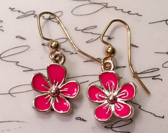 Dainty hot pink flowers on gold tone ear wires.