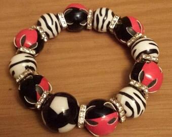 Red black and white bracelet