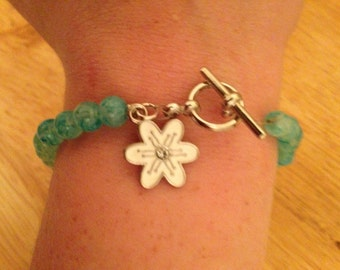 Toggle clasp beaded bracelet with flower charm