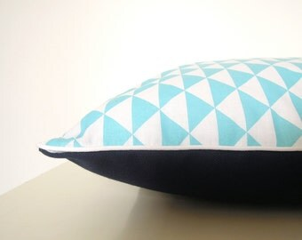 """Cushion """"Turquoise graphic Triangles, marine canvas and white piping"""""""