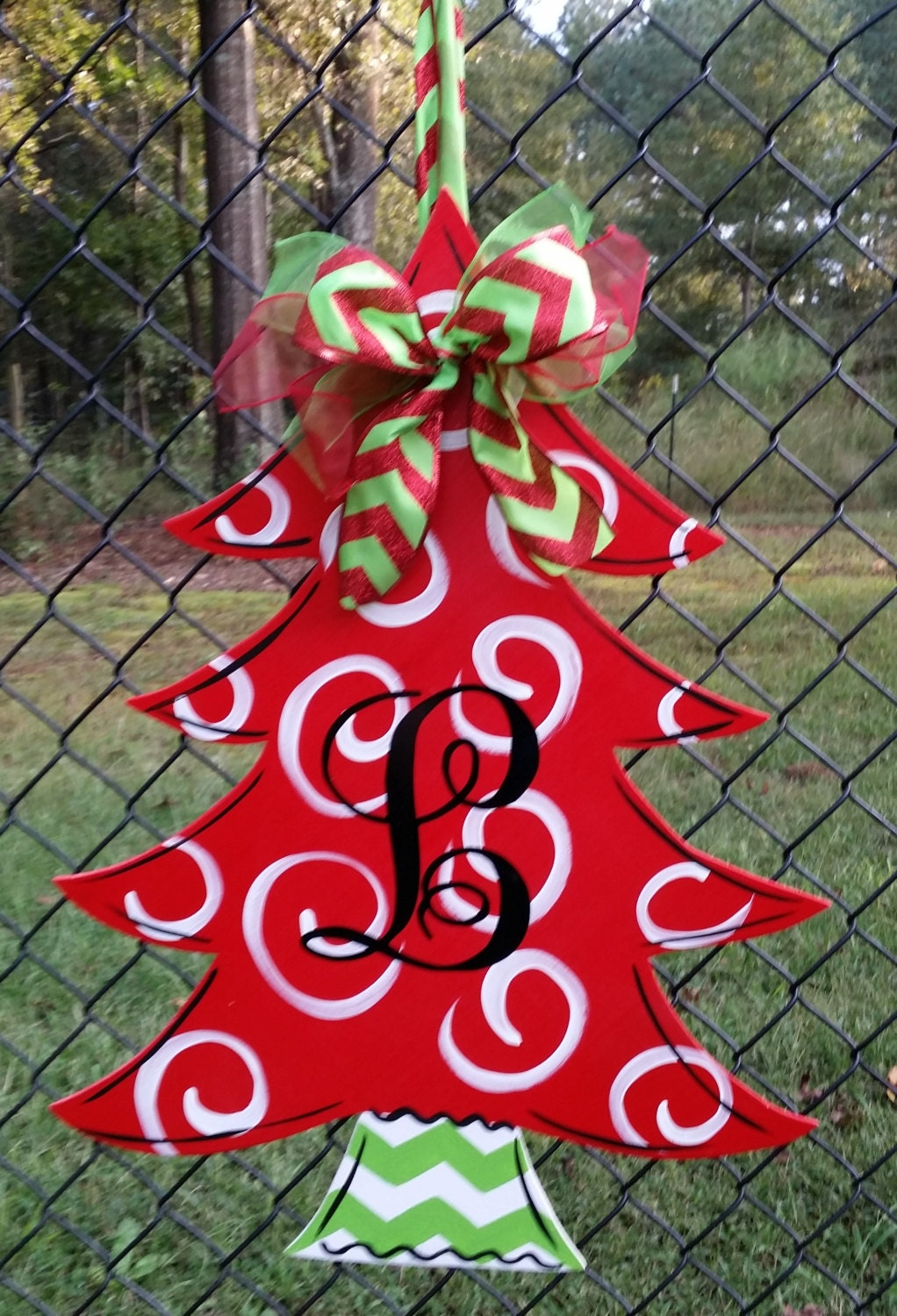 Christmas tree with monogrammed initial door decoration