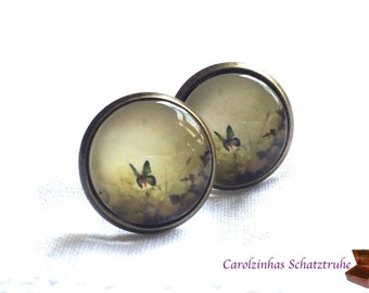 Summer Meadow brown-colored earrings with butterfly