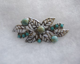Vintage silver coloured brooch with turquoise lapis style stones     158