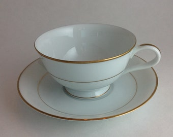 Classic and Elegant Noritake Teacup and Matching Saucer White with Gold Band and Trim Fine Dining Traditional Fine Bone China