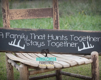 A Family That Hunts Together Stays Together Primitive Rustic Wood Sign with deer antlers
