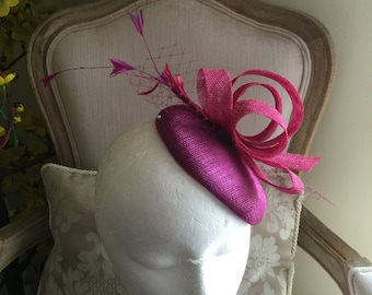 Gorgeous magenta round fascinator with magenta loops, feathers and netting. Stunning!
