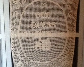 "Crocheted ""God bless our home"" wallhanging"