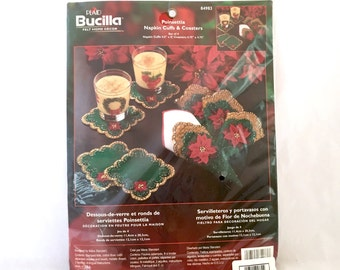 Plaid Bucilla Poinsettia Napkin Cuffs and Coasters, Set of 4, Applique Kit, Embroidery Felt Napkin Rings, Green and Red Christmas 84983
