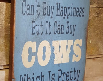 Money Can't Buy Happiness, But It Can Buy Cows, Which Is Pretty Much The Same Thing, Humorous, Western, Antiqued, Wooden Sign in LIGHT BLUE