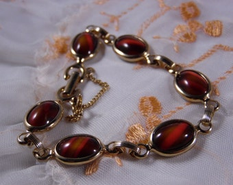 Sarah Coventry Gold-Plated Bracelet With Glass Cabochons .