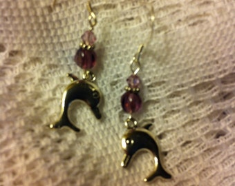 Amethyst aurora borealis and sterling silver pierced earrings with dolphin charms.