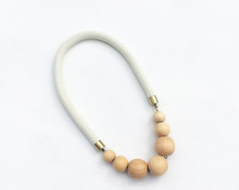 Ivory rope necklace with brass and natural beads