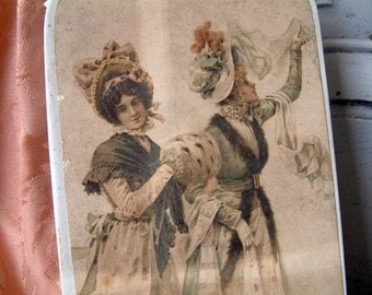 Antique french glove box with lithograph of women. Antique paper box with lithograph of young women in late 18th century dress.