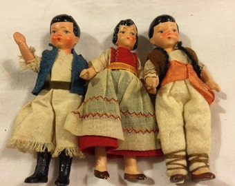 Three vintage miniature regionally costumed dolls