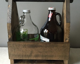 Hand crafted rustic industrial growler carrier in dark walnut with iron pipe handle