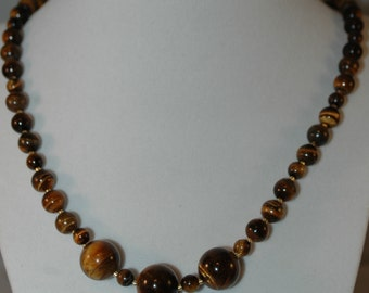 Tigereye Necklace, 23 inchs long, closes with a toggle clasp