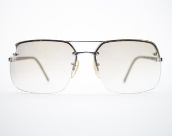 Vintage 70s Sunglasses | Silver Aviator Sunglasses | Light Amber Lenses | 1970s Sunglasses | Vintage Deadstock - Vail Silver