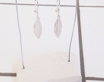 Silver earrings with fine feather