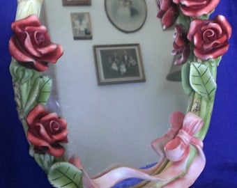ornate oval rose mirror/ picture frame
