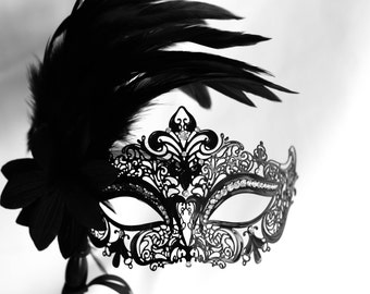 masquerade black mask, masquerade metal mask with feathers and a stick fit for masquerade ball parties