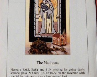 Lovely appliqued fabric stained glass wall hanging The Madonna from Cathy Robiscoe of Spectral Designs
