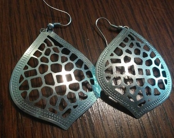 Two pair of earrings.  One set of silver plated hoops and one set of silver plated leaf earrings.