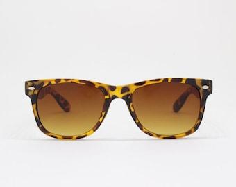 Tortoise horn rimmed sunglasses, 40s wayfarer style frame. Classic vintage style glasses