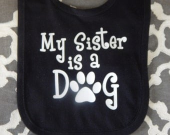 My Sister or Brother is a DOG baby bib , black bib for boy or girl / pet / doggy / puppy / sibling / paws
