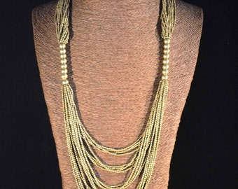 NEW PROMO - Long necklace in brass beads. Tribal style. Ethnic