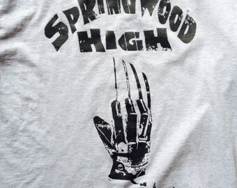 A Nightmare on Elm Street Inspired T-shirt 1984 Freddy Krueger. Classic one color distressed Tshirt. Screen Printed