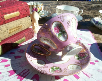 Pretty in Pink Vintage Teacup and Saucer, Hand Painted, Iridescent Glazing and Gold Gilt. Dimpled Cup and Saucer with Hand Painted Roses.