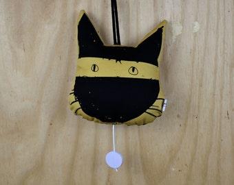 musical clock ninja. light yellow