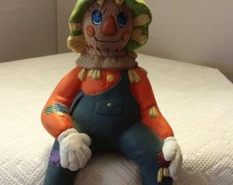 Sitting Ceramic Scarecrow