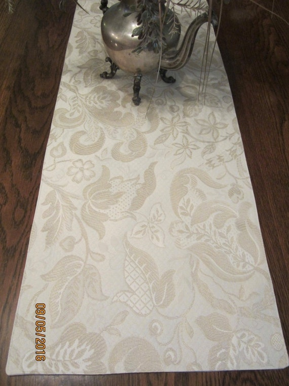 White and neutral colored woven botanical fabric table runner in two sizes
