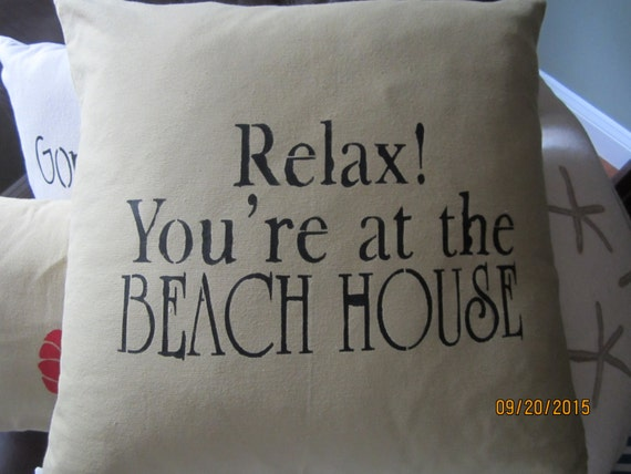 Beach themed 18 inch throw pillow with stencil in khaki colored cotton canvas