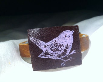 leather wrist cuff with printed swallow