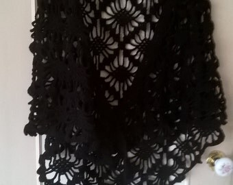 A Ladies hand crocheted black patterned shawl