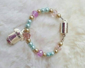 Adorable bracelet for your reborn baby. Fits 0/3 or 3 mos size reborn dolls