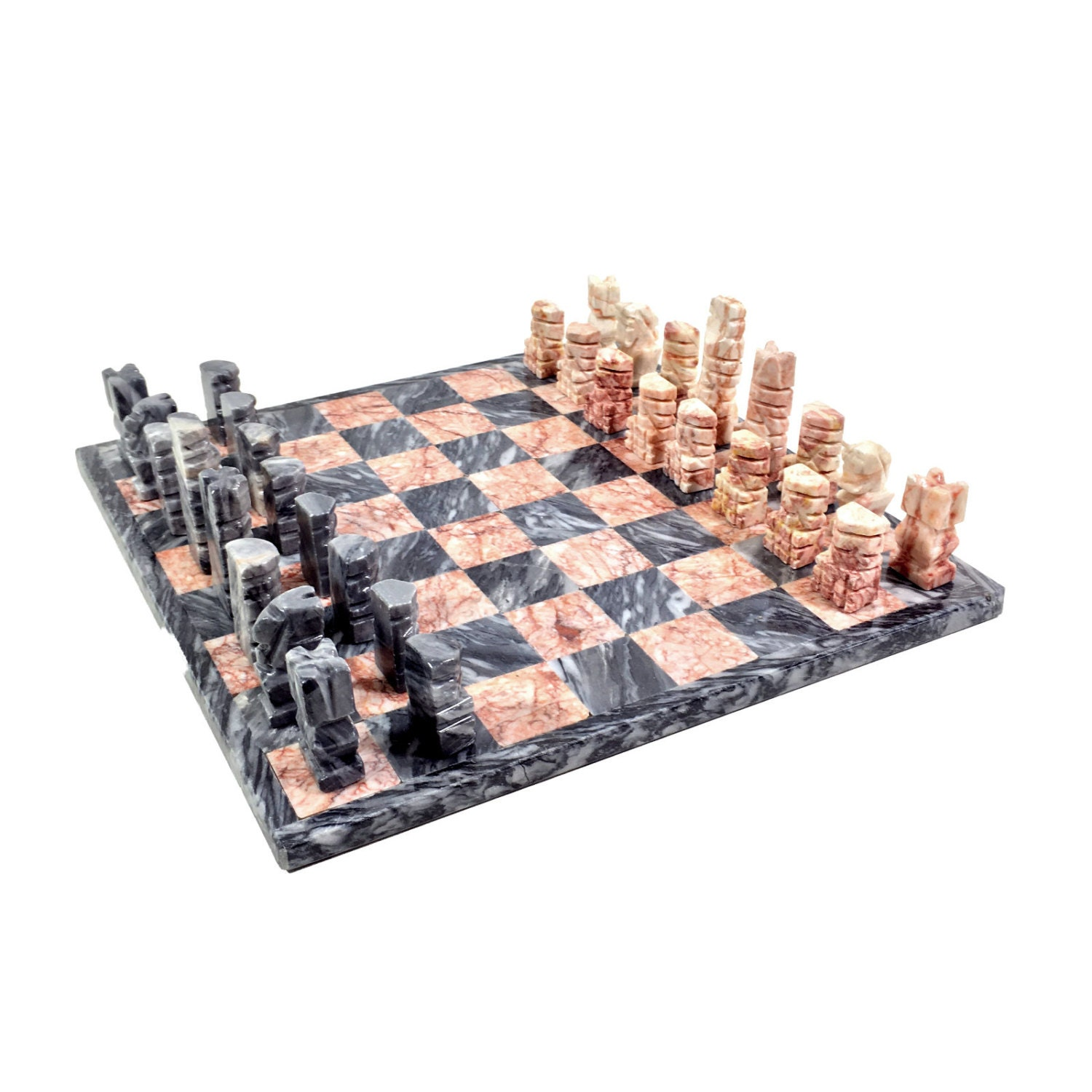 Vintage carved stone chess set with black pink pieces and - Granite chess pieces ...