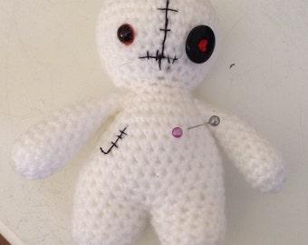 Voodoo doll pincushion.