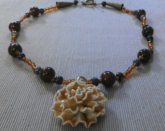 carnation ~ blue: matinee length necklace of glass & ceramic beads, porcelain flower pendant