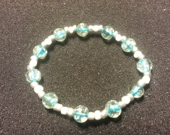 Clear glass beads with turquoise inside with silver & white beads