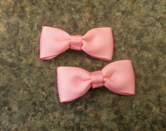 Set of 2 mini pink hairbows on snap clips