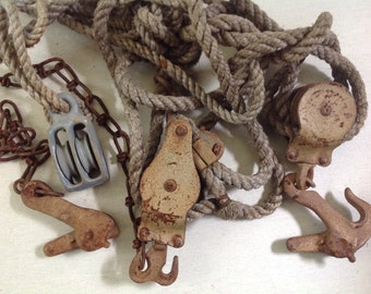 Rusty old block and tackle with rope and pulley's  vintage fishing tool