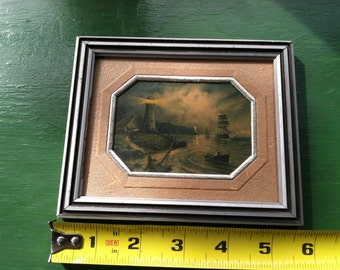 small framed lighthouse seascape lithograph