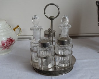 Revolving Cut Crystal Condiment Set with Salt, Pepper, Oil and Vinegar, and Mustard Pot.