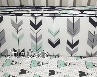 Organic crib bumper in organic tribal navy gray mint arrow print & stripes; coordinating navy blue trim.