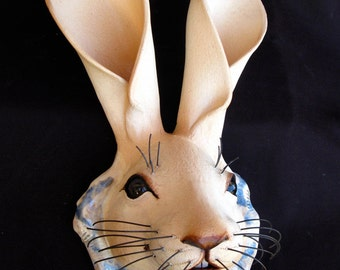 Ceramic wall mounted rabbits for in or outdoors