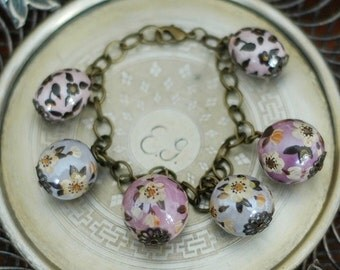Charm bracelet with hand painted ceramic beads